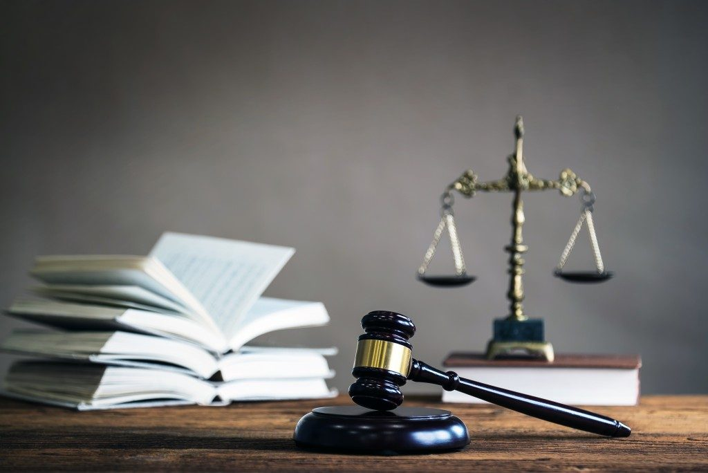 Books, scale of justice and a gavel