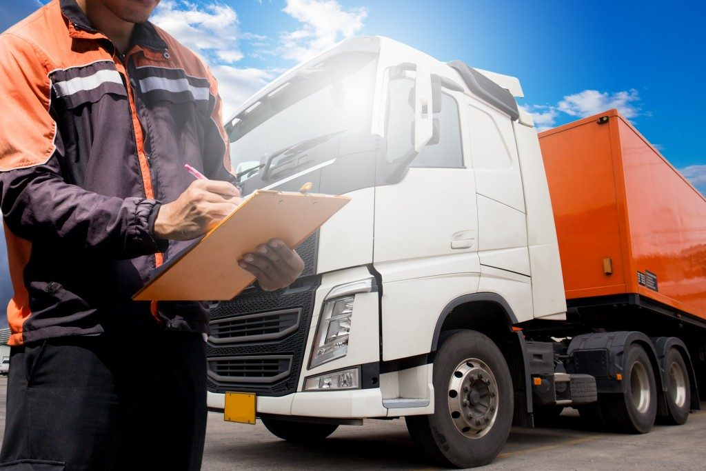 truck driver keeping tabs on transport logistics