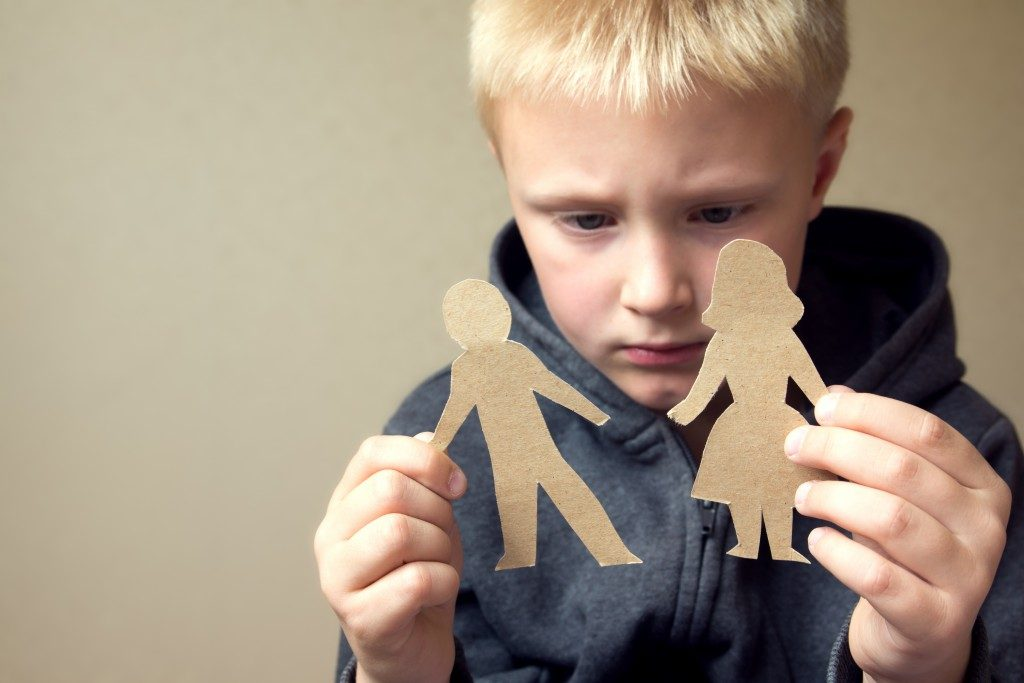 child looking at a cutout of man and woman