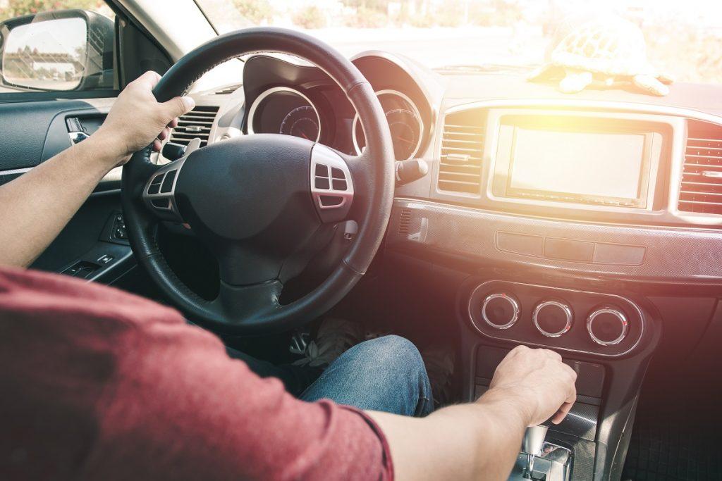 man driving, shifting gear