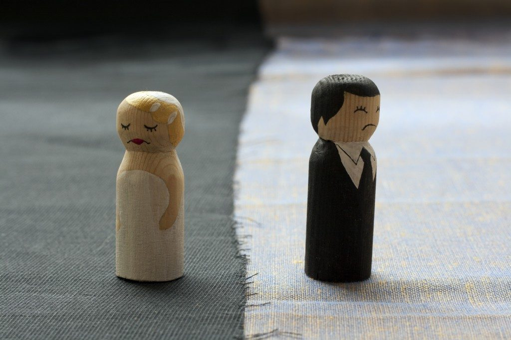 wife and husband wooden figurine