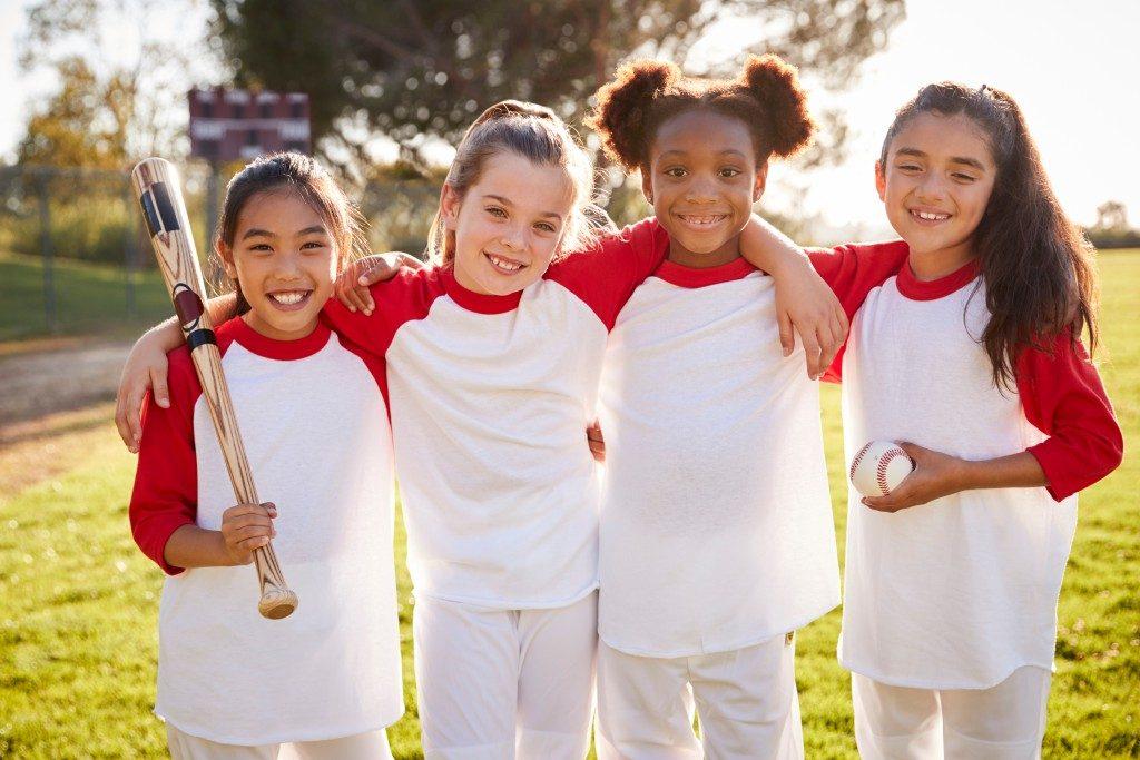 Little girls playing softball