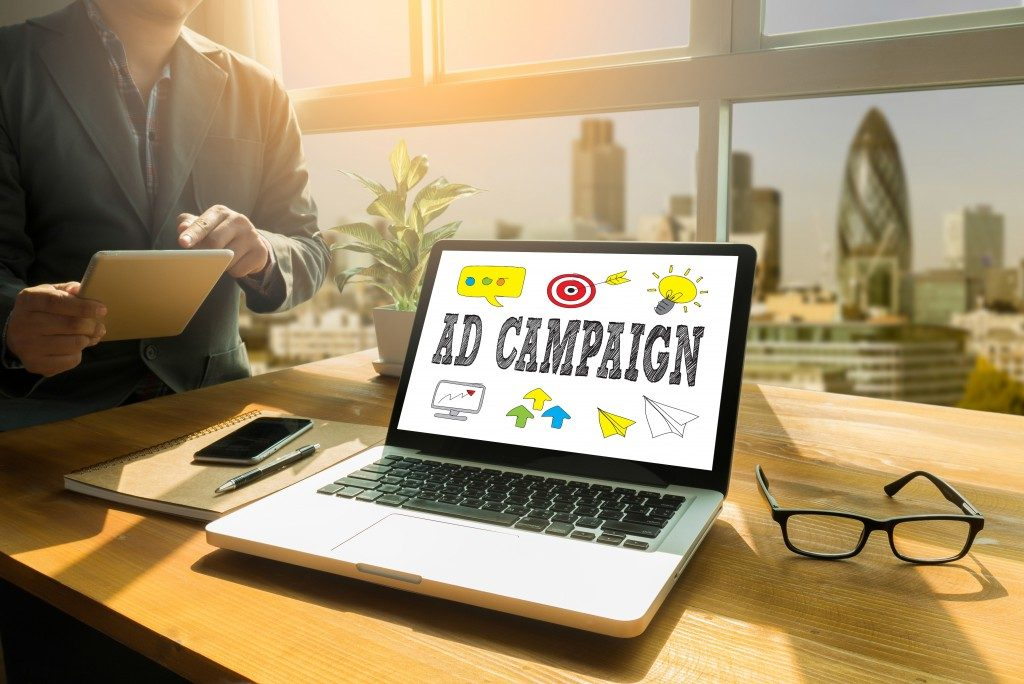 Ad campaign word and icons shown on laptop screen