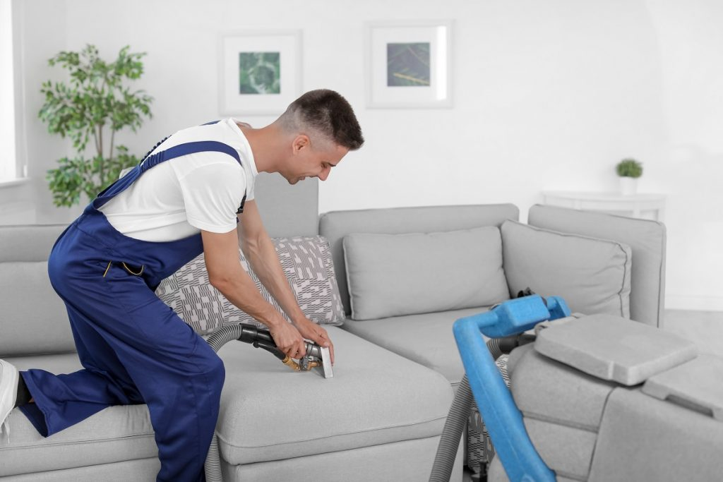 guy cleaning the sofa