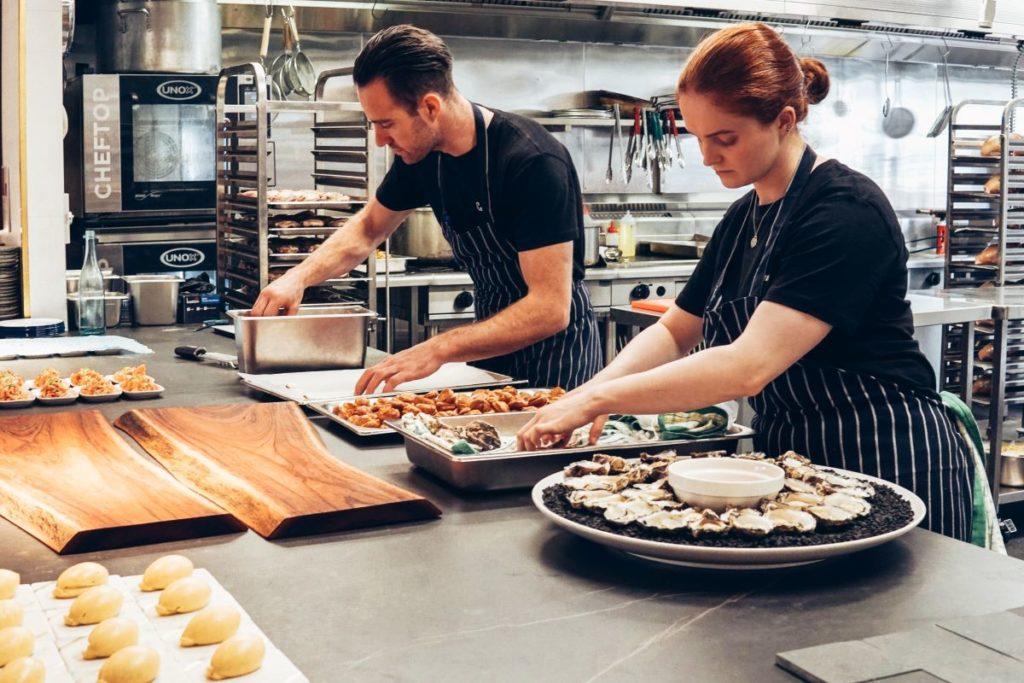 cooks preparing platter