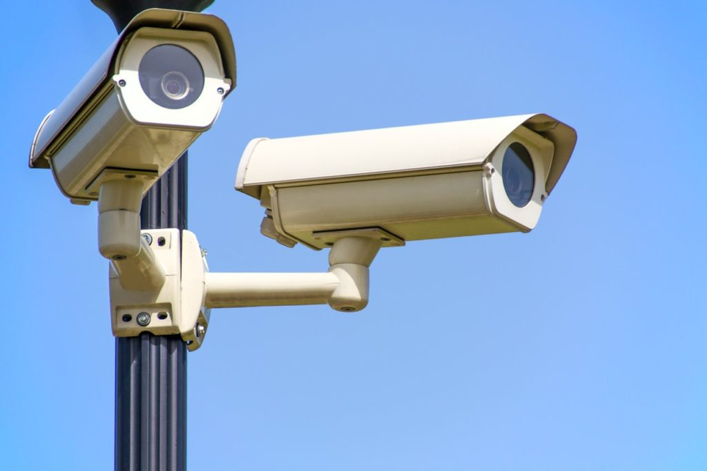 2 security cameras pointing in different directions