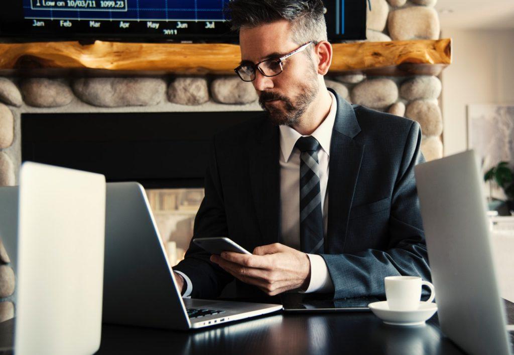 business man gadgets phone laptop