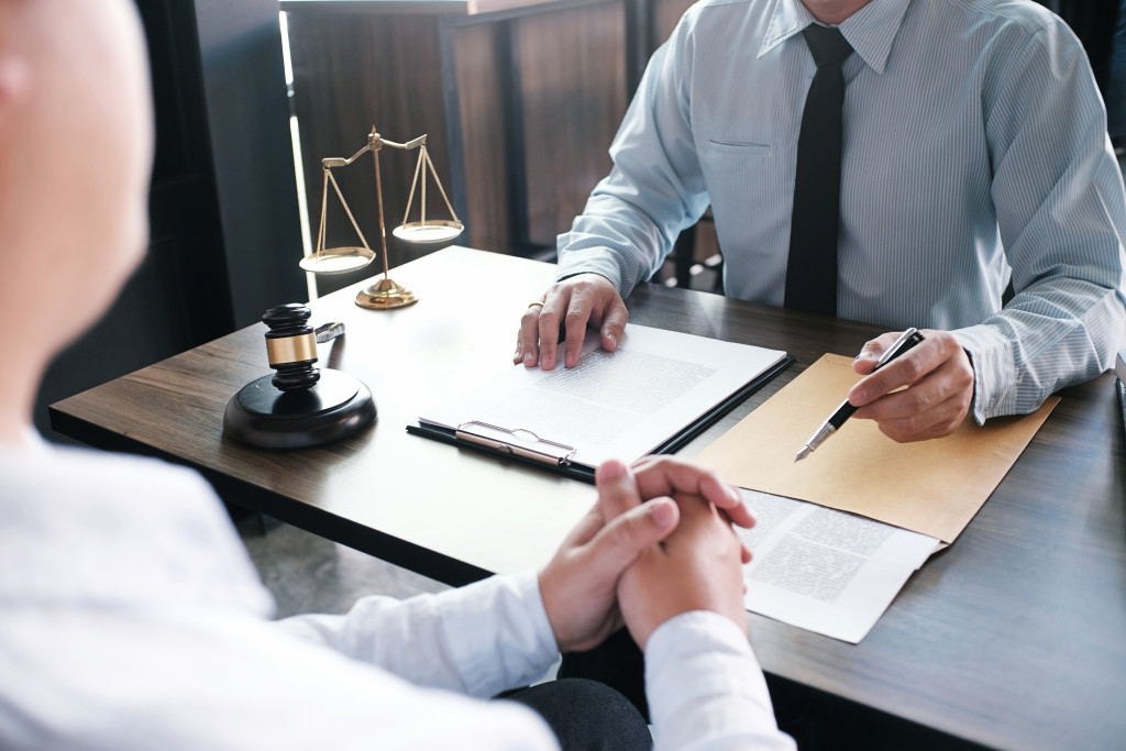 person speaking to a lawyer