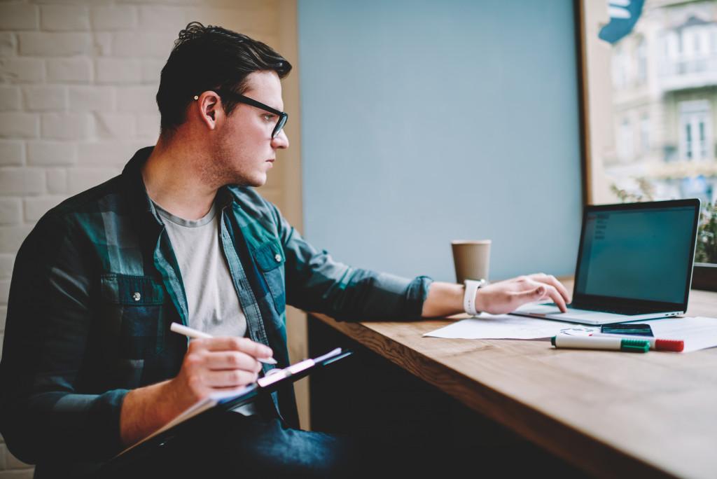 man working on laptop computing