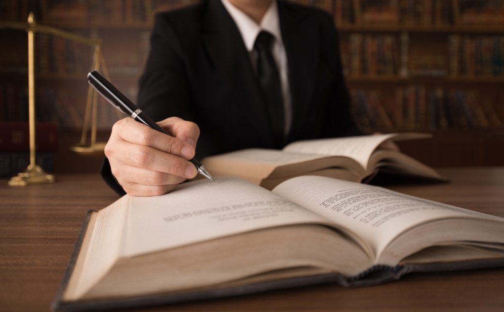 lawyer writing in book