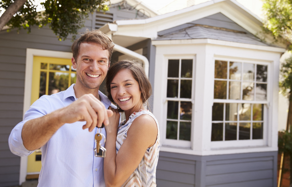 young couple owning a home