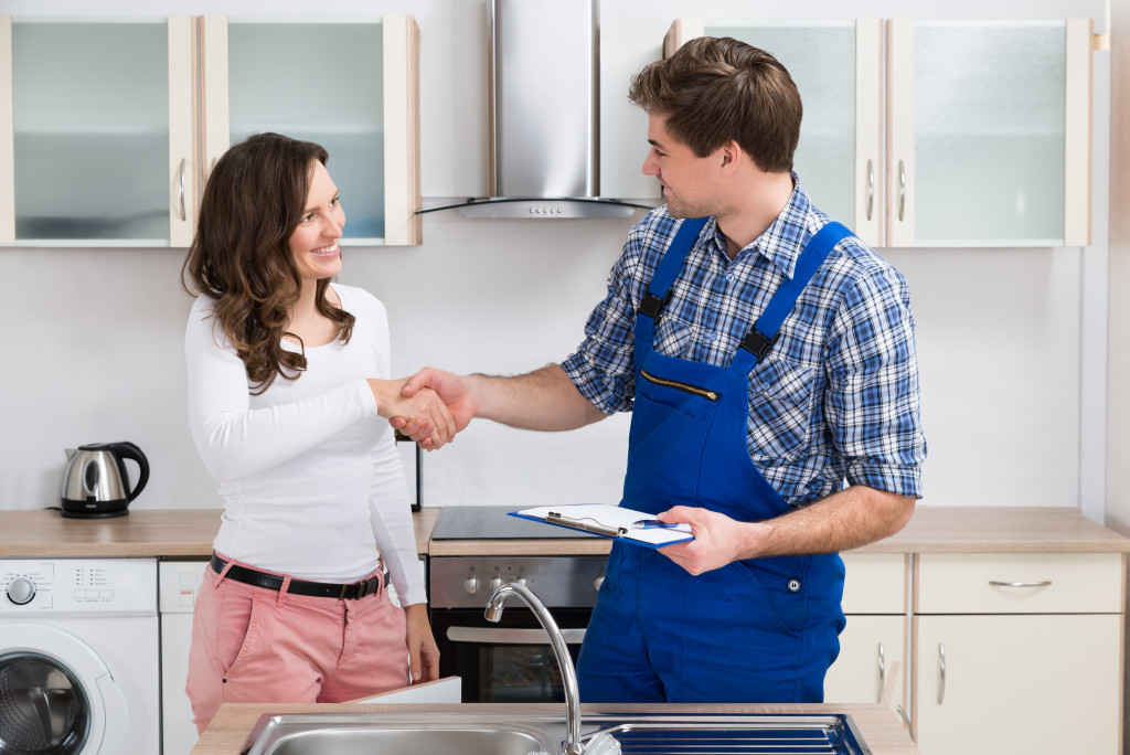 hiring professional services to check home maintenance