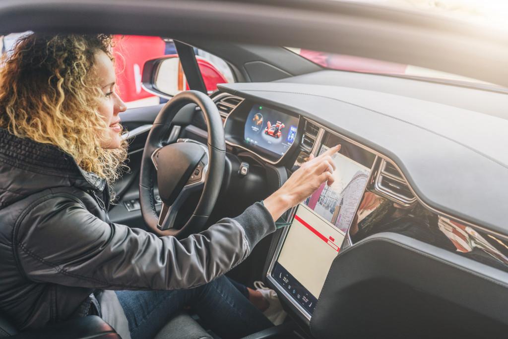woman driving a modern car